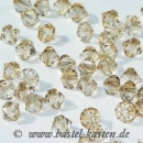 Swarovski Doppelkegel 5301  6 mm crystal golden shadow (10 Stück)